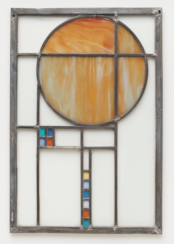 clear glass panels with yellowish-brown and white streaked circle; square made up on 4 small rectangles (turquoise, blue, lilac and orange); row of small rectangles (yellow, lilac, blue, white, orange and turquoise)