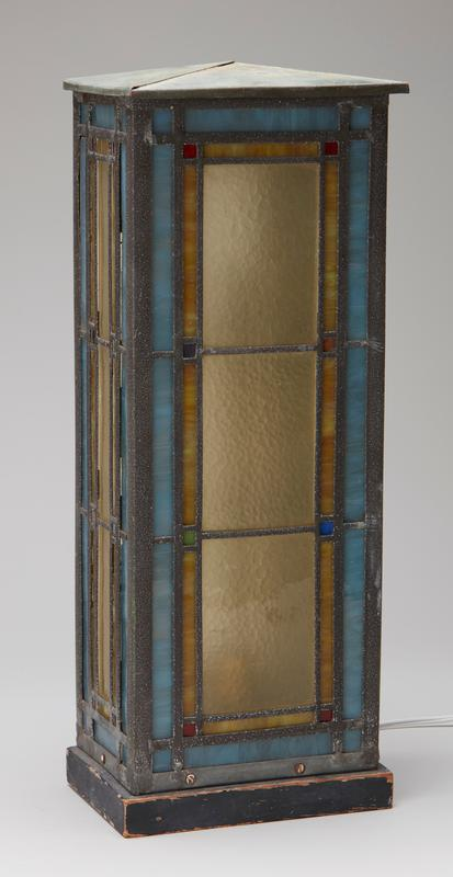 rectangular shape; removable top; block designs on 4 sides in yellow, blues, red and green leaded glass