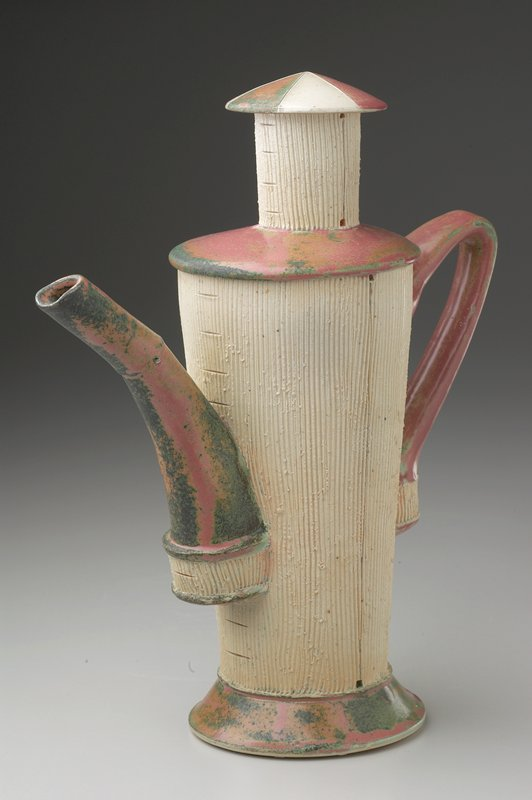 flaring cylindrical vessel on slightly flaring foot with large handle and spout of similar shapes; nearly flat shoulder with short neck and small convex lid; body and neck unglazed with parallel incised vertical lines; spout, handle, foot and shoulder glazed pink with green areas