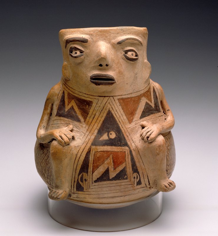 Pot in the form of a Seated Figure,polychrome earthenware,Mexico, Casas Grandes,XIIc. Red, black, and brown on cream slip. Pierced eyes, open mouth, incomplete head, applique arms.