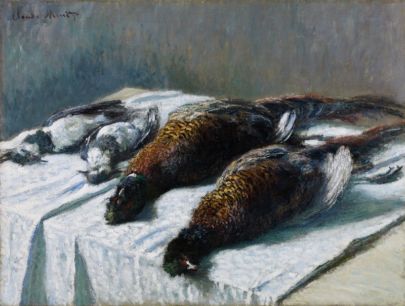 Still life with pheasants and plovers laid out on a white tablecloth