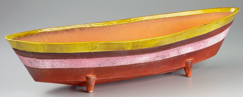 boat-shaped vessel with bright orange interior, glossy yellow rim and dull orange body with light pink stripe; 4 small legs