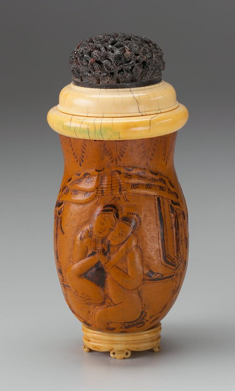 gourd decorated with 2 cartouches surrounding couples engaged in intercourse; attached ivory base; domed cover with tortoise shell carved with birds amid flowering tree