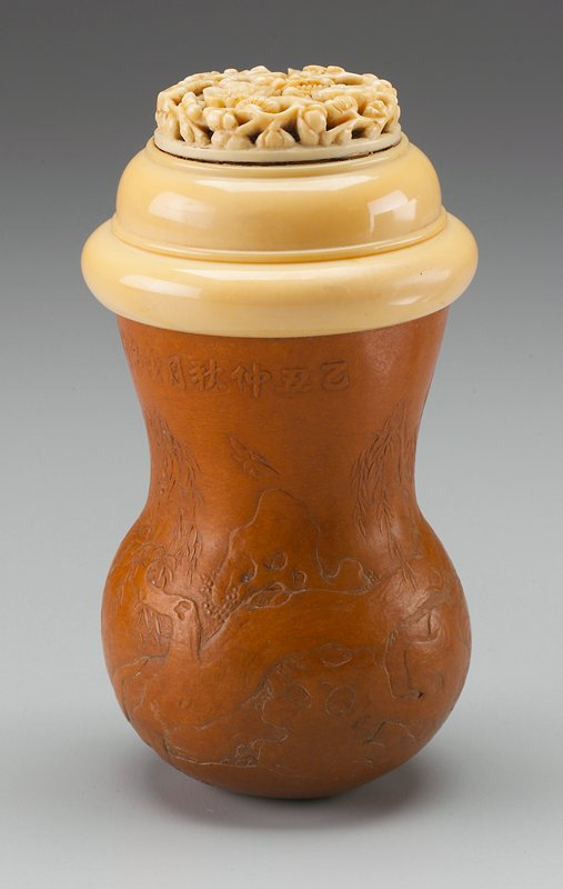 gourd molded with a tree and inscription around top edge; flat-topped cover carved with flowering branches