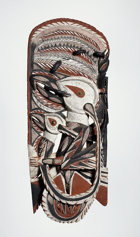 wood frieze carved with birds whose eyes are made of green turbo shell opercula; painted serpents wind their way across the relief; covered with lime and painted in red, black, and white pigments; carved for use in the Malanggan rites when it would be placed in a special hut with other sculptures