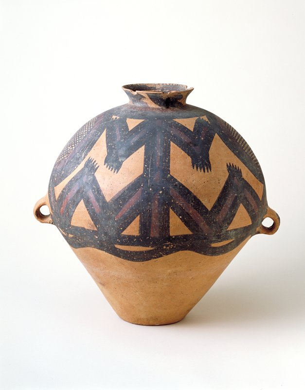 Funerary Urn, Yang shao culture, Ma-chang type, earthenware with black and purple painted decor, two handles. Decor unusual in showing two stylized kneeling figures between cross-hatched circles.