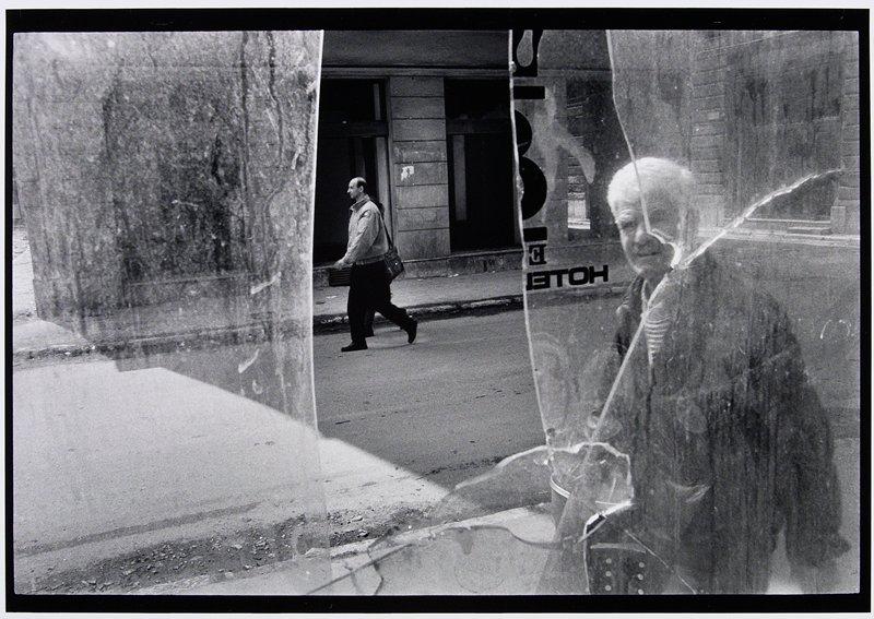 man seen through broken window