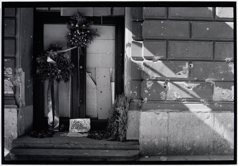 building entry with wreaths and bouquets