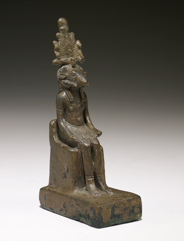 the creator, (the potter) in a seated attitude with ram's head and wearing the Atef crown. hollow cast figure representing the ram-headed god Khum, the deity of the Elephantine