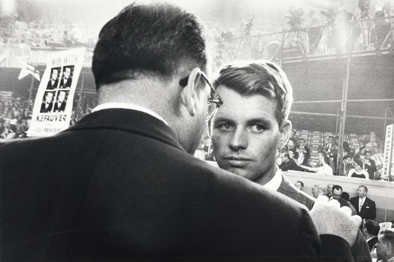 man with back to camera talking to Robert Kennedy