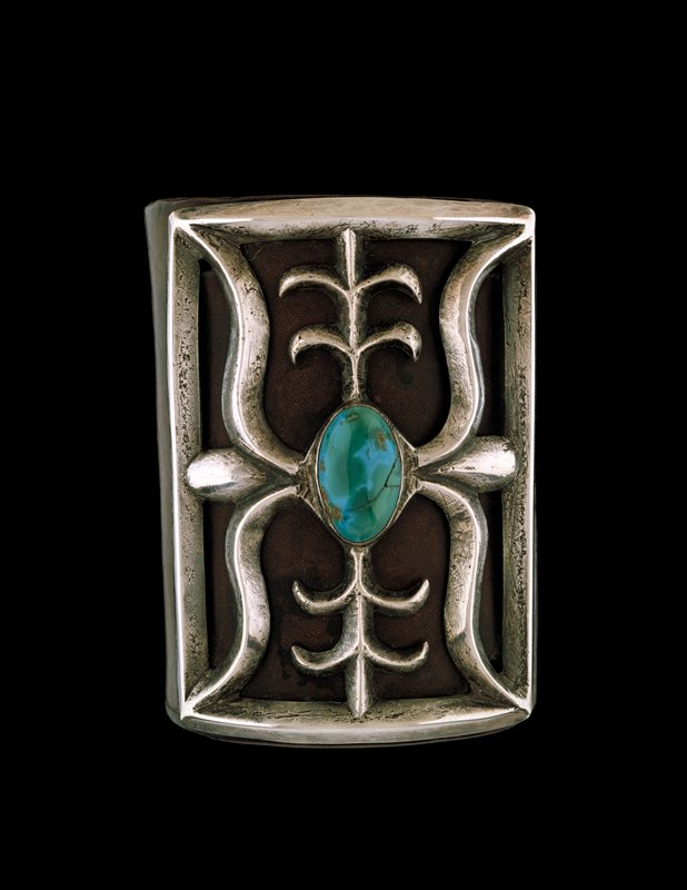 Ketoh; cast mounting on leather band; set with single cabochon Nevada turquoise; J# 1087, Cat# 602, Illustrated p 143