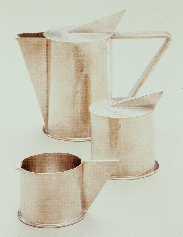 Tea service includes teapot, creamer, and sugar basin.