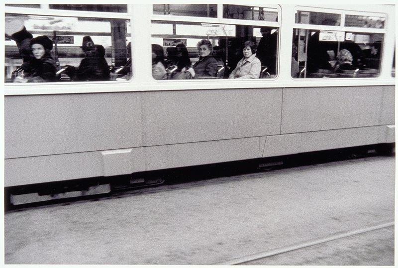 three train windows with women passengers