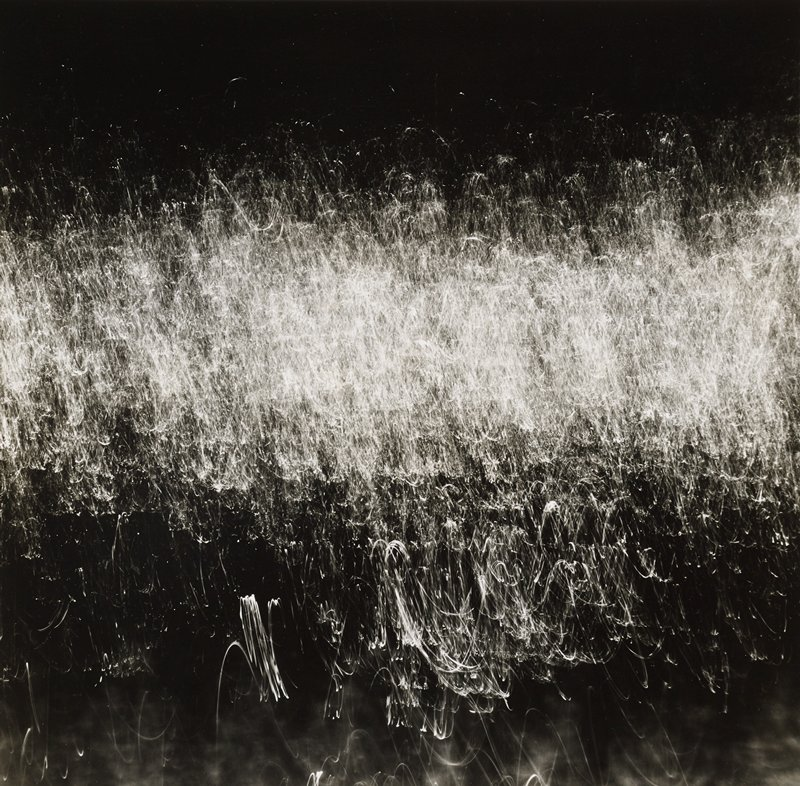 abstract image with light white hairlike horizontal band near center