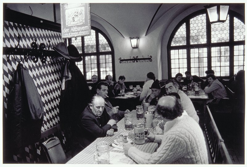 photograph of interior with men at a table