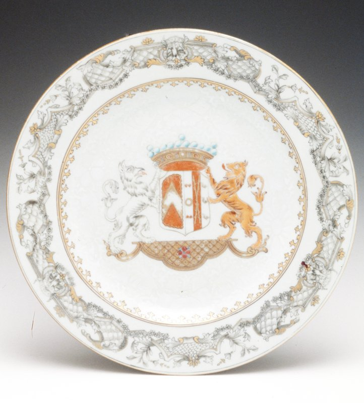 incised floral borders, center with Arms of Van Herzeele in enamel colors, gilt trim