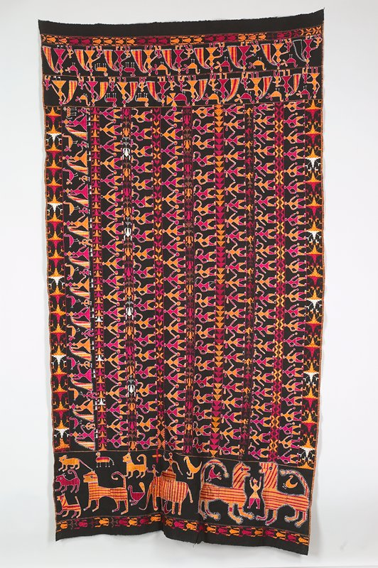 black ground with rows of figures in pink, orange and white; geometric borders; one end has fantastic animals