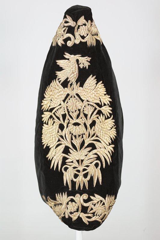 black velveteen ground; gold metallic embroidery