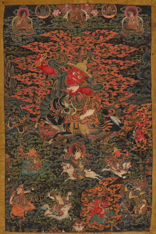 figure with red skin wearing a gold hat, riding on a black horse; 4 figures floating on clouds at top; 8 small figures on horseback and riding other animals at bottom; green silk cover