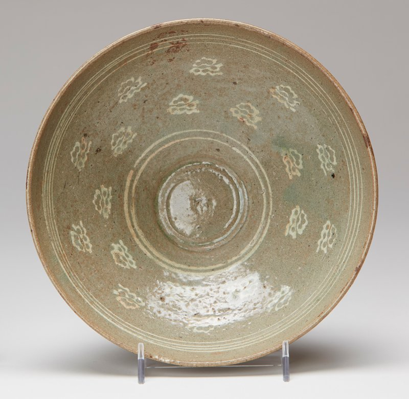 Bowl, slightly incurving lip, thin glaze inside decorated with small cloud motives.