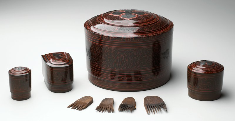 bell-shaped box with stepped cover; organic patterns overall in red on brown