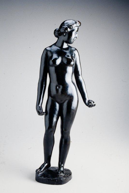 standing female figure holding an apple in her proper left hand