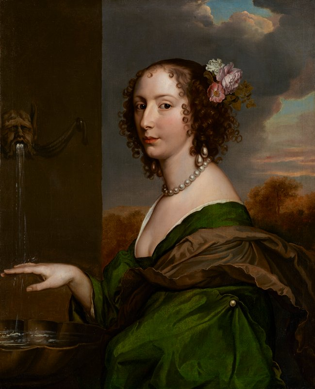 Portrait of a woman in a green dress and brown scarf with flowers in her hair, pearl necklace and earrings, at a fountain.