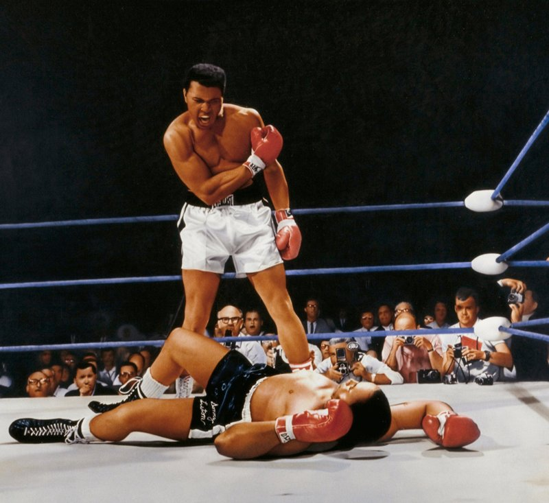 History. Figure. Genre. Sport. Ali standing over a knocked out Liston