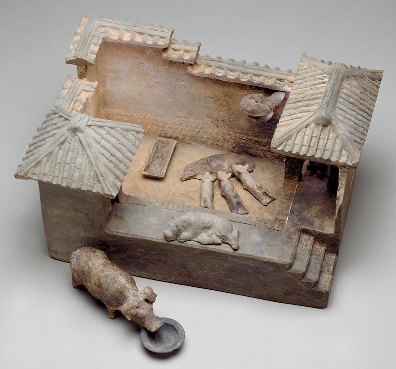 Slab built and modeled, rectangular courtyard surrounded by a tile roofed wall; seperate elements are a pigsty, boar, round food dish, rectangular food dish, seated figure, bird, dog, suckling pig, four piglets.