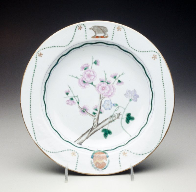 soup plate grey glaze floral center, rose, purple and green floral garland borders, armorial crest of Chambers impaling Wilton