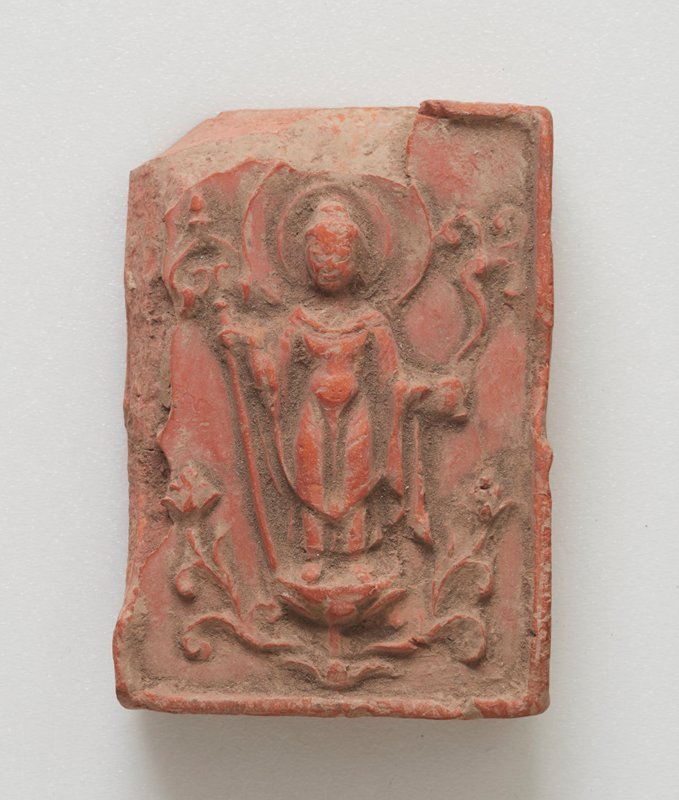 small fragment with carving of a standing figure