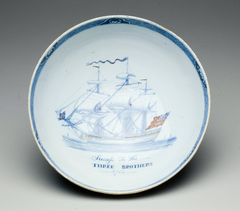 ceramic bowl, blue and white with sailing ship within bowl, exterior decorated by two outdoor scenes and two birds in flight
