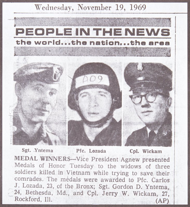 newspaper photograph of three men in military uniforms