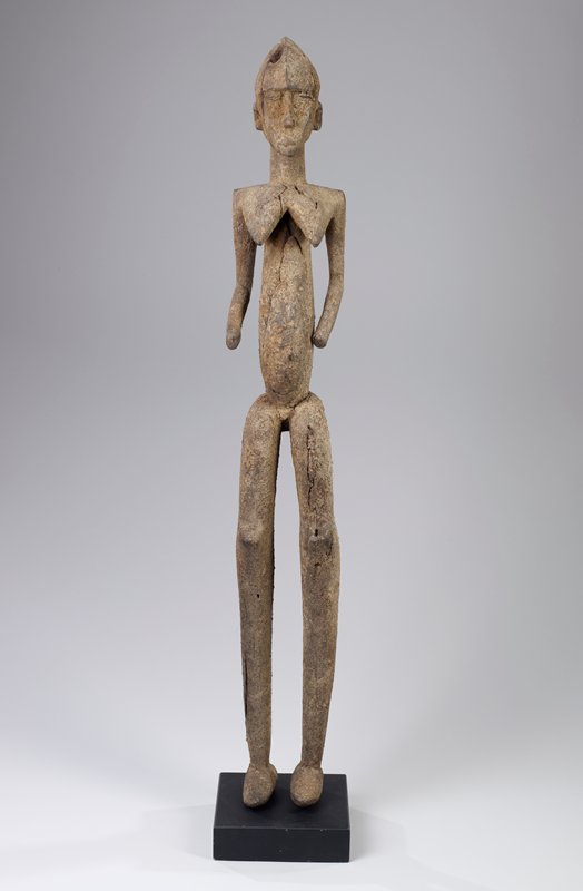 elongated body; very long, thin legs; arms slightly bent at elbows; pointed face; encrusted patina