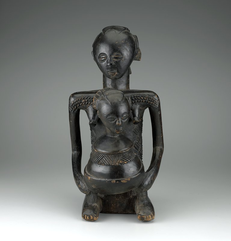seated female figure holding a vessel