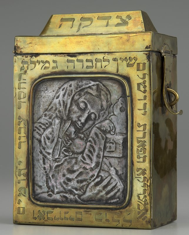 brass box with handle; slit in hinged lid; decorated with Hebrew and repoussé image of woman and boy on front