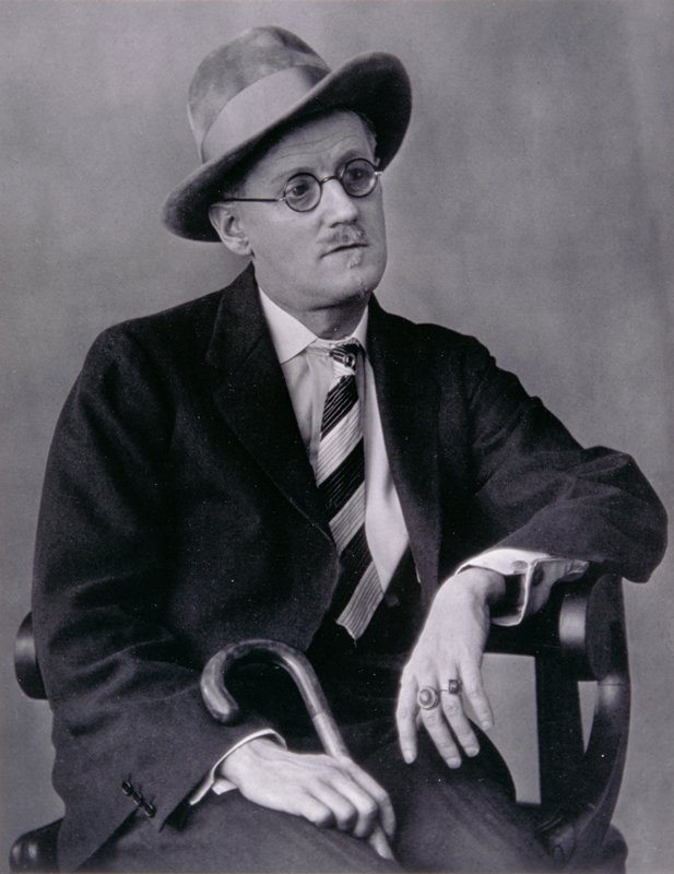 James Joyce, seated and holding cane