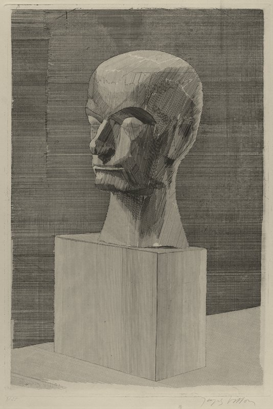 image of blocky sculpted head on a tall, rectangular base