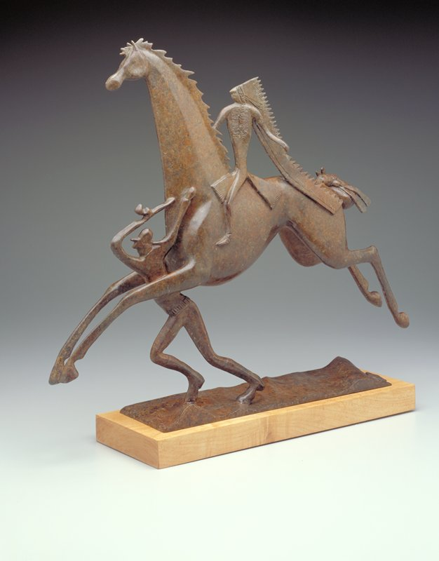 galloping horse with flat, stylized rider (wearing long headdress); flat, stylized figure beneath front legs of horse; incised decoration on both figures (front only); on wooden base (attached)