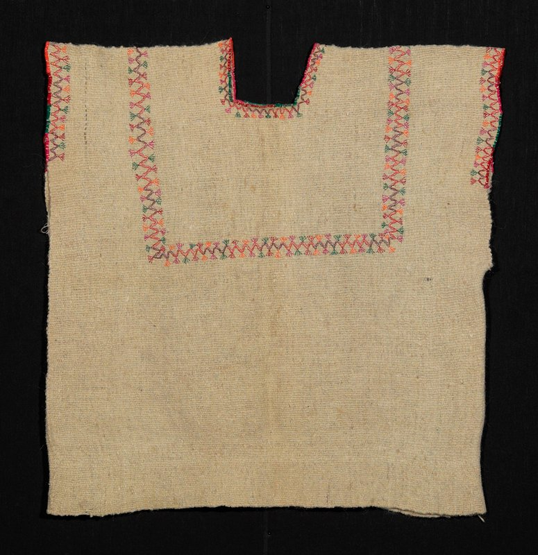 white woolen one-paneled huipil; embroidered decoration on sleeves and neckline
