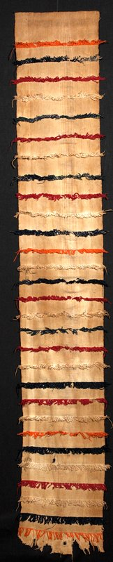 cut weft pile stripes in orange, red, natural on oddly-dyed tan ground