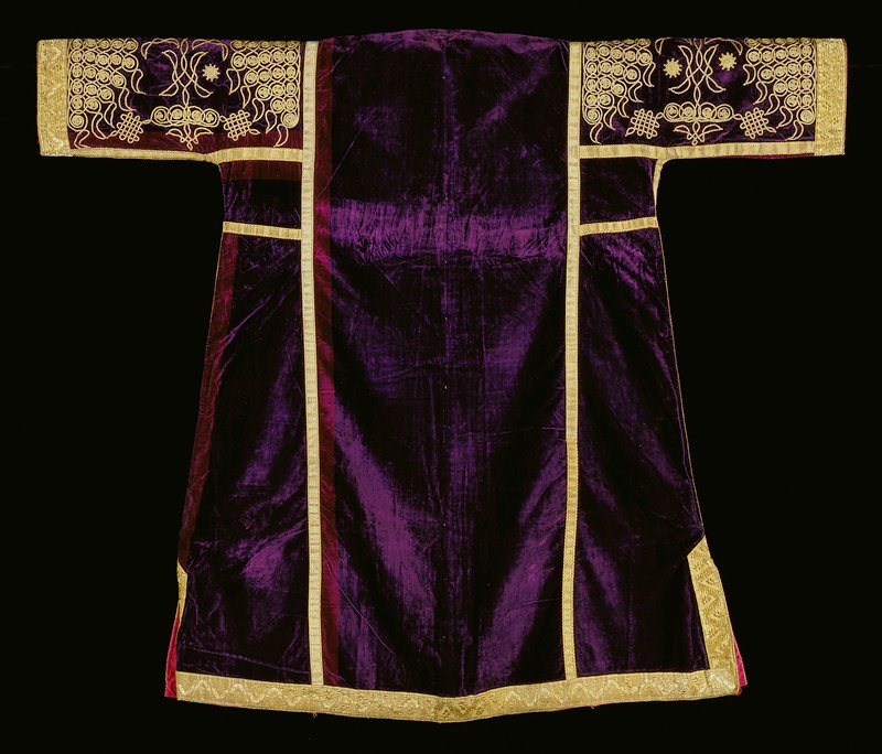 Purple velvet coat with gold cord buttons and gold trim; gold cord in scrolling designs at center, hem and front and back of sleeves; lined with pink and white