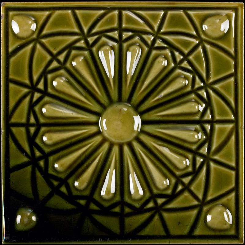 floral design at center with lines and arcs; green glaze