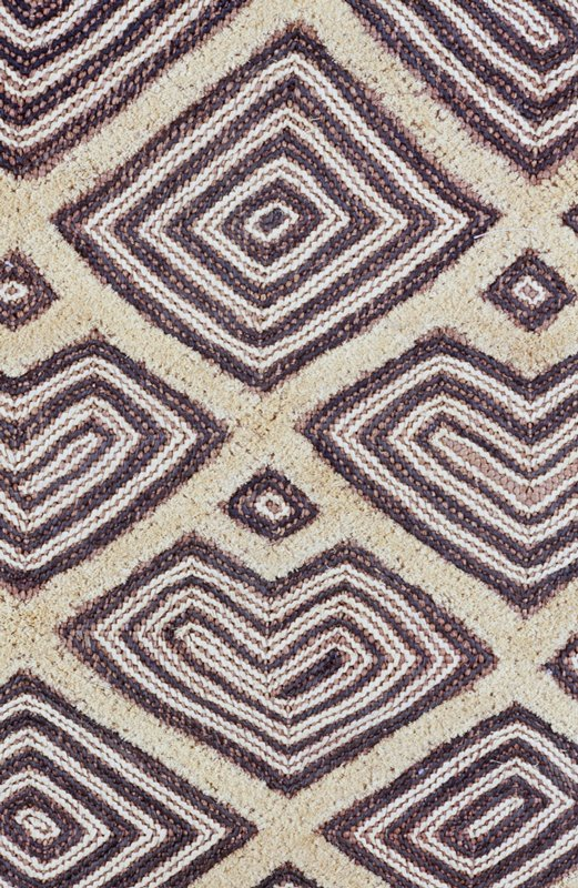 tan and brown, with geometric diamond motif design