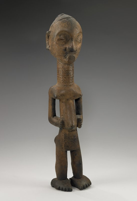 asexual figure standing with legs apart, hands on stomach; long neck; thick, protruding lips; possibly female figure
