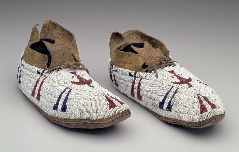 rawhide soles; tanned uppers; beaded throughout top in red, white and blue, with thunderbirds on vamps