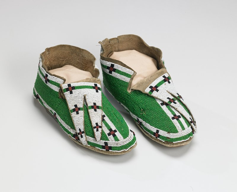rawhide soles; tanned uppers; split tongues; tops beaded overall with stripes and crosses in green, black, red and white