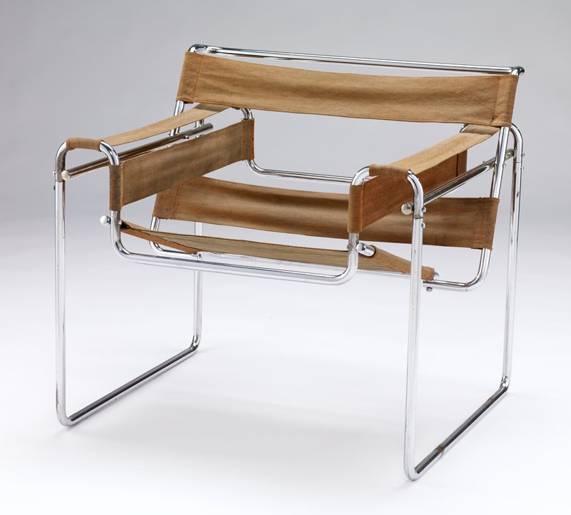 chrome frame with 7 brown fabric strips: 2 at each arm and back, large strip for seat