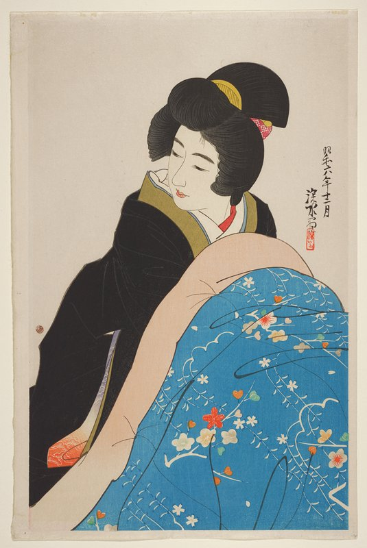 portrait; woman wearing a black kimono, burrowing her arms under a blue floral printed blanket with pink trim