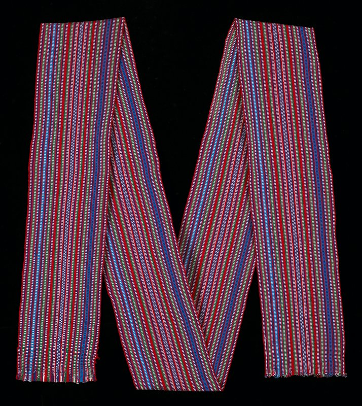 Striped sash with 4 selvedge ends; purple, green, blue warp stripes, all of them with small white warp stripes simulating a checkerboard effect; multicolored stripes are intercepted with red stripes.